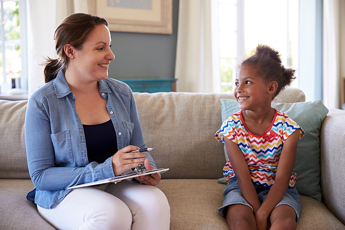 photo of a child specialist working with a young girl