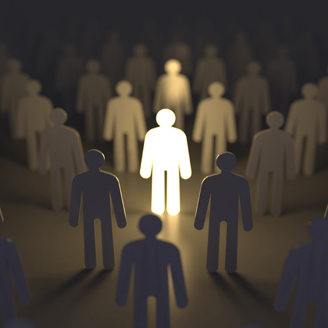 photo of a person standing among a crowd, highlighted to represent an individual person